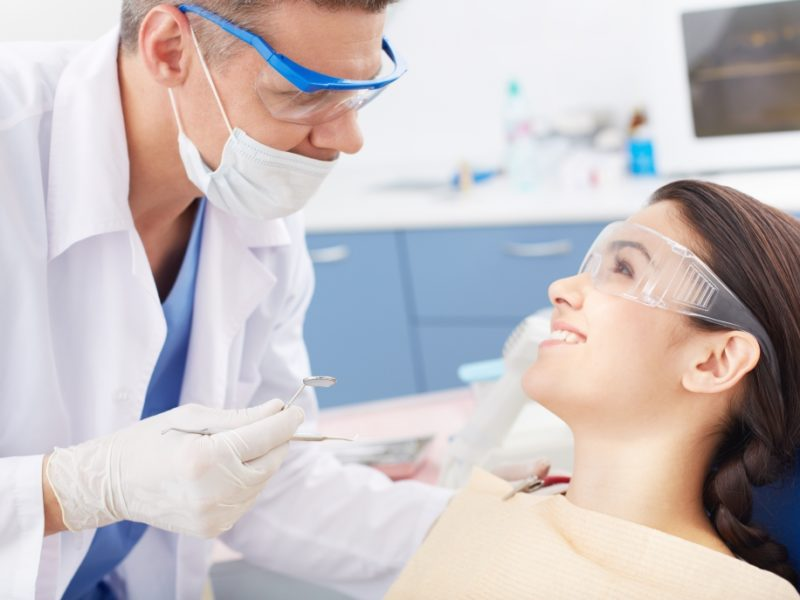 Young woman visiting dentist